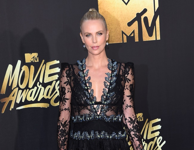 Theron criticized for letting her son wear a dress