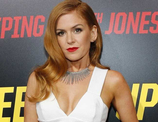 Isla Fisher lacks a social life, and she's okay with that